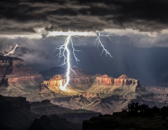 Photographer Rolf Maeder used a long exposure to capture several lightning strikes hitting the Grand Canyon under atmospheric stormy skies./ Rolf Maeder:Rex Features