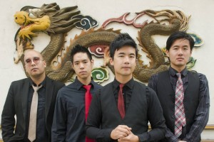 Simon Tam, foreground, with members of his band the Slants. :PHOTO- ANTHONY PIDGEON:REDFERNS:GETTY IMAGES