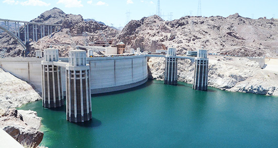 The level of Lake Mead behind Hoover Dam, as shown in this July 2014 photo, has fallen to record low levels. A continued decline would prompt the U.S. Department of the Interior to declare a shortage that would trigger a first stage of cuts in Arizona's deliveries of Colorado River water through the Central Arizona Project.