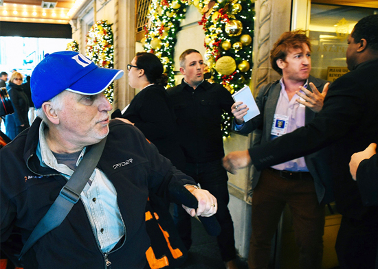 Reporters, along with protesters, are pushed out of New York's Plaza Hotel, where Donald Trump was speaking at a fundraising luncheon, on Dec. 11, 2015. /Timothy A. Clary:AFP:Getty Images