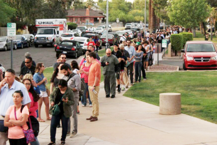 Voters planning on participating in the Arizona presidential preference election were forced to wait in line anywhere from one to four hours to vote at the Salvation Army Phoenix Citadel in downtown Phoenix on Tuesday. /Craig Johnson:Downtown Devil