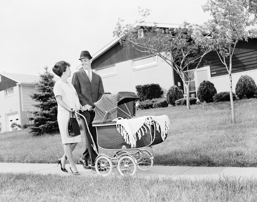 UNITED STATES - CIRCA 1960s:  Mother and father pushing baby in pram.  (Photo by H. Armstrong Roberts/Retrofile/Getty Images)