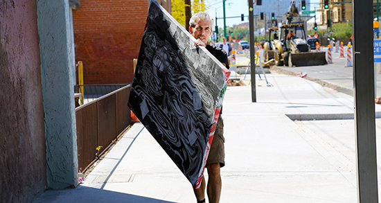Turner Davis of Tucson delivers his work to Eye Lounge and Contemporary Art Space, an arts collective at 419 E. Roosevelt St. /Photo by Gary Grado, Arizona Capitol Times