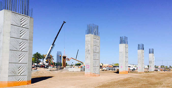 ADOT workers prepare to construct an overpass on Bell Road at Grand Avenue (U.S. 60) in Surprise, a project that has some similarities to plans for an overpass in Maricopa. /ADOT photo