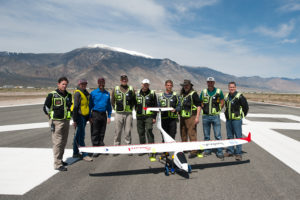 NIAS, DRI and Drone America members pose after a successful flight of Drone America's Savant sUAS with cloud seeding flares at the Hawthorne Industrial Airport in Hawthorne, Nev. on Friday, April 29, 2016. /Photo by Kevin Clifford/Drone America