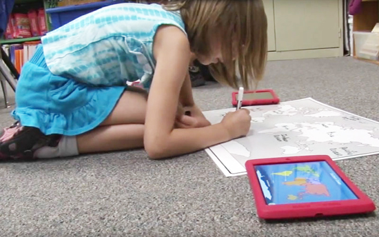 Tempe grade school student works on a maps project./:File photo