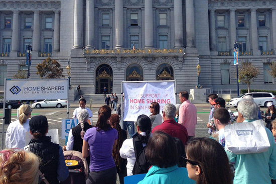 Supporters of home-sharing services recently gathered outside Sam Francisco City Hall. /Flickr/Kevin Krejci