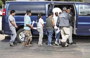 Suspected illegal immigrants detained during a raid on a manufacturing plant in Mississippi.